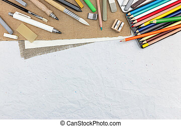 artist drawing tools on recycled paper background