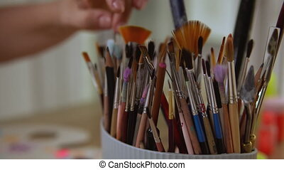 Artist finds exact paintbrush for her art design. - Variety...