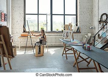 Artist in own studio