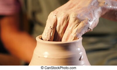 Artist operates hands, which gently creating correctly...