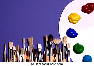 Painters white pallette and paints with painters brushes. Signs and symbols of art.