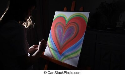 artist painting in the night