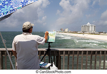 Artist Painting Shorefront - Artist uses a small brush to...
