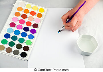 Artist painting with tray of water based paint