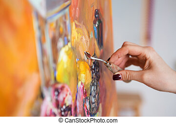 artist paints a picture of oil paint with palette-knife