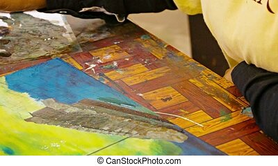 Artist paints a picture with oil paints. Cambodia, Siem Reap