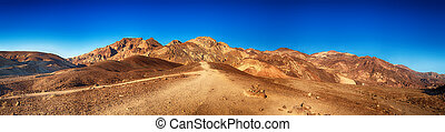 A panoramic view of The Artist's Palette, in Death Valley California, so called because of the natural multi-coloured mineral deposits within the rocks.