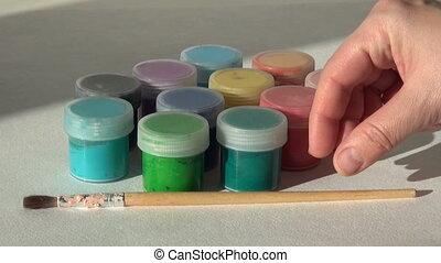artist puts a brush. Acrylic gouache paint. Homework, the...