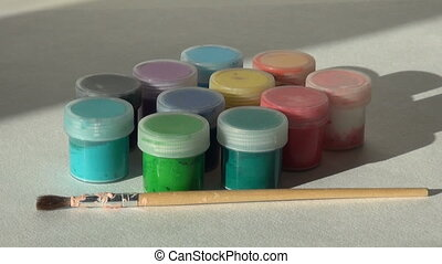 artist puts and takes brush. Acrylic gouache paint....