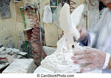 Artist Sculpting Alabaster - Artist sculpting alabaster in...