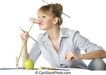 Artist smelling flower