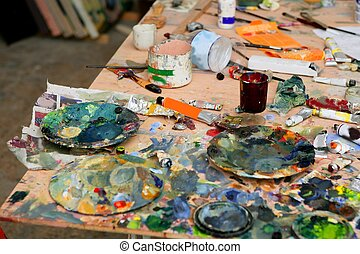 Artist studio painted dirty table, colored in many colors