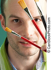artist with brushes