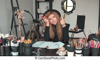 Artist with Pencils - Happy artist with gorgeous fair hair...