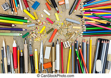 artist work tools on brown recycled paper top view