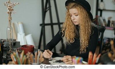 Artist Works on Sketch - Focused artist working on sketch,...