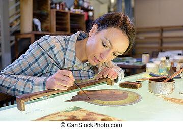 artista, no trabalho