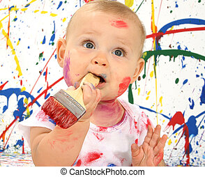 Artistic Baby - Beautiful baby covered in bright paint with...