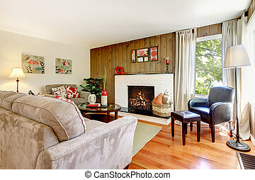 Artistic beautiful living room with fireplace and wood wall.