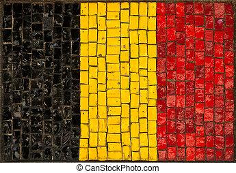 old Belgium flag made as window-pane. detail photo.