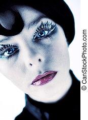 Artistic blond girl wiyh blue eyes