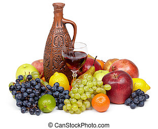 Artistic composition of fruit and jug of wine on white
