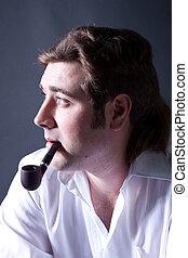Artistic dark portrait l man smoking a pipe