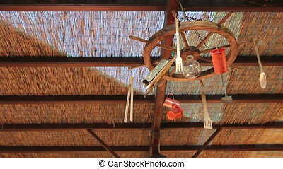 Artistic design hanging on canopy in a typical outdoor Greek...