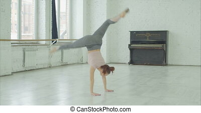 Artistic emotional dancer in whirl of dance - Artistic...