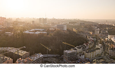Artistic Kiev School and Construction workers at work are at the top of the building on Vozdvizhenka in Kiev