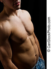 Artistic portrait of muscular male bodybuilder