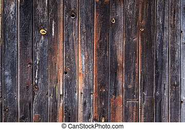 artistic texture of an old wooden fence in black and brown tones - close-up rustic background