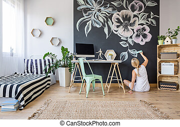 Artistic woman in bedroom