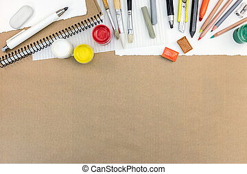 artistic work tools: paints, colored pencils and chalks, different paintbrushes