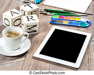 Artistic workplace mockup with black coffee. Painting tools and accessories