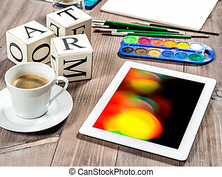 Artistic workplace mockup with black coffee. Watercolor, brushes, tablet PC