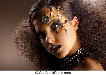 Artistry. Extraordinary Shiny Woman in Shadows. Golden Makeup. Creativity