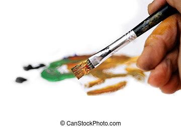Painter's hand and brush