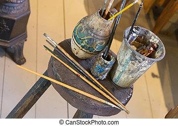 Artist's brushes, vintage setting