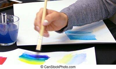 artist's hand draws a gradient