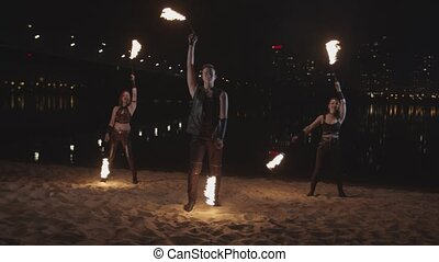 Artists performing amazing fireshow poing at night -...