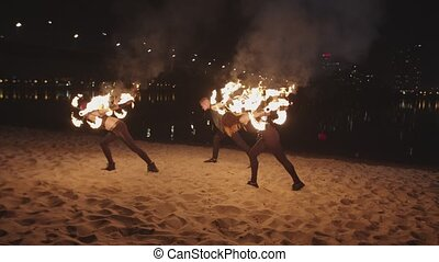 Artists performing stunt with rolling staves - Young...