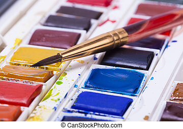 Artists watercolour paints with brushes and pencil background hobbies and leisure time