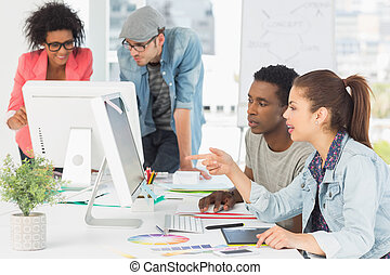 Artists working at desk in creative