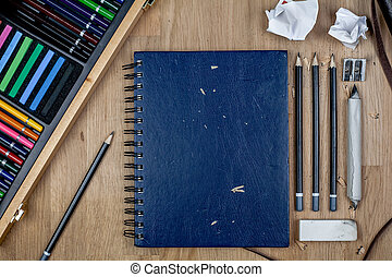 Arts & Crafts Sketchbook Flat Lay on Wooden Background
