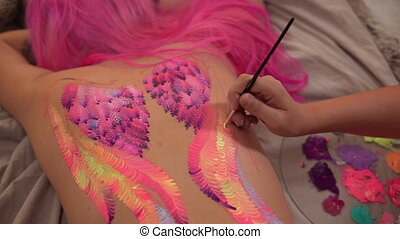 Artwork on a girls back - Juicy coloured wings backview....