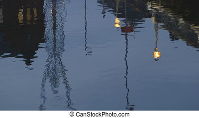 Artwork Statue and Lights Reflected in Water - Steady,...