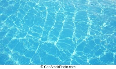 Arty celeste swimming pool waters with shimmering sunny rays...