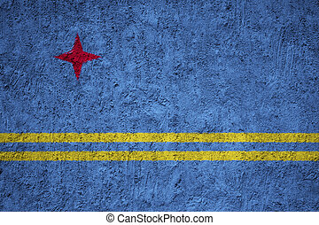 Aruba flag painted on the cracked grunge concrete wall