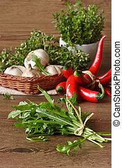 Arugula. - Bunch of arugula and vegetables on a wooden...